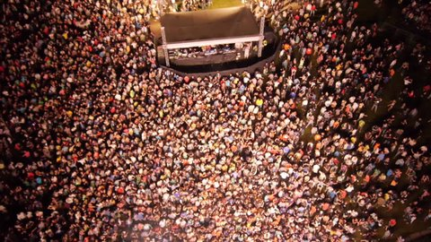 AERIAL: People partying on a outdoors music concert