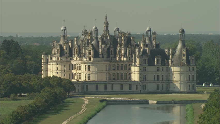AERIAL France-Flight Over Chateau De Chambord 2006: Chateau Chambord approach, tight and low, then rising up and pan round