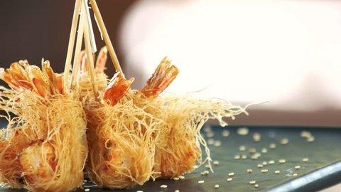 Shrimp tempura close up. Fried prawns, kataifi dough.