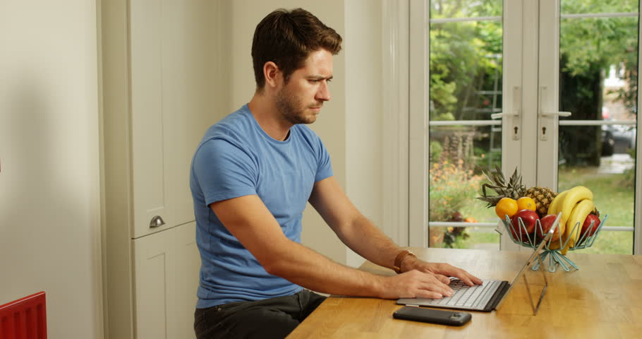 4K Worried entrepreneur working on computer, concerned about company finances | Shutterstock HD Video #1006607842