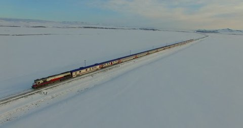 Aerial shot of a snowy place with train(Eastern Express) passing, Kars/Turkey