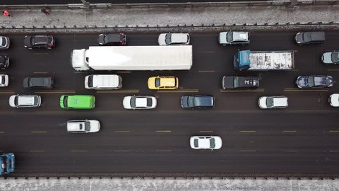Aerial view of car traffic on the Paton bridge in Kiev, Ukraine. Car traffic jam.