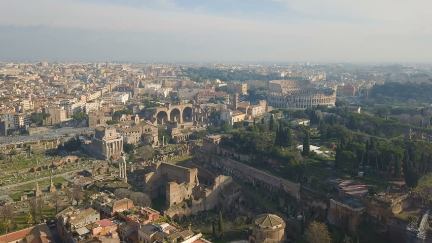 Cityscape of Rome. Aerial view of Colosseum and ancinet Roman ruins