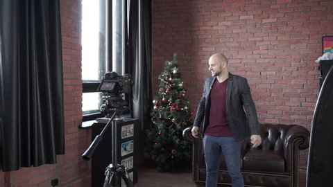 Young man blogger hypnotist recording himself on camera for online internet vlog for social media
