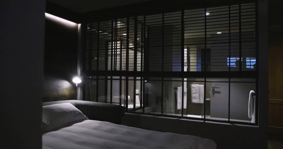 Location of a bedroom interior with soft and romantic light. Concept of: vacation, hotel, relaxation, bedrooms.