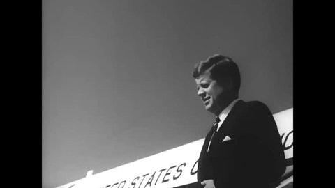 CIRCA 1962 - John F Kennedy is greeted by military officials at Fort Bragg, and transported by convertible.