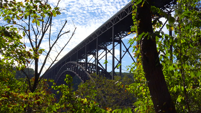 WEST VIRGINIA - CIRCA 2010s - Low angle establishing shot of the New River Gorge Bridge in West Virginia. | Shutterstock HD Video #1006705408
