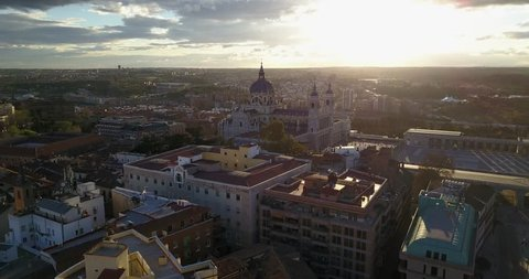 Aerial drone view of Royal Palace of Madrid, Spain at sunset