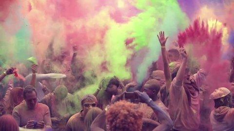 hamburg - germany, octobers 2016. multi ethnic group of teens celebrating holi festival color, shot in epic slow motion
