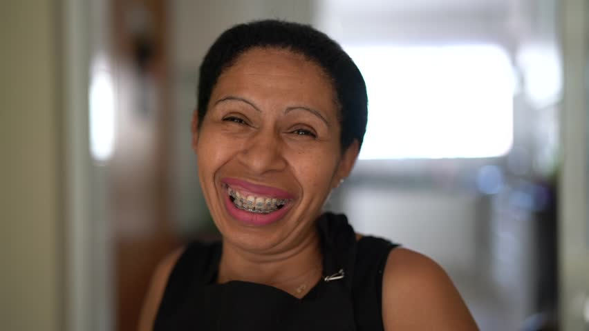 Portrait of a happy latin woman at home