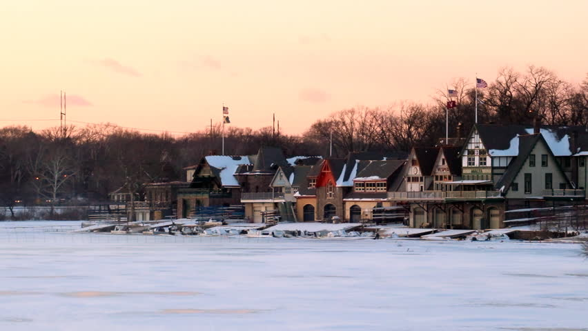 Philadelphia boathouse row in winter sunset with frozen river