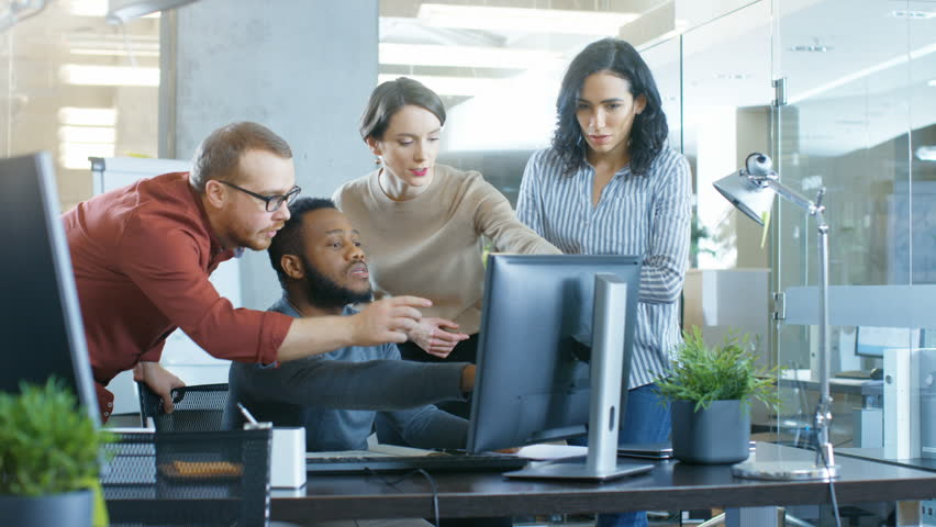 In Busy Corporate Office Team of Diverse Young Creative People Work on a Problem Solution. Collectively They Try to Help Coworker to Solve Problem. Shot on RED EPIC-W 8K Helium Cinema Camera. | Shutterstock HD Video #1006915318