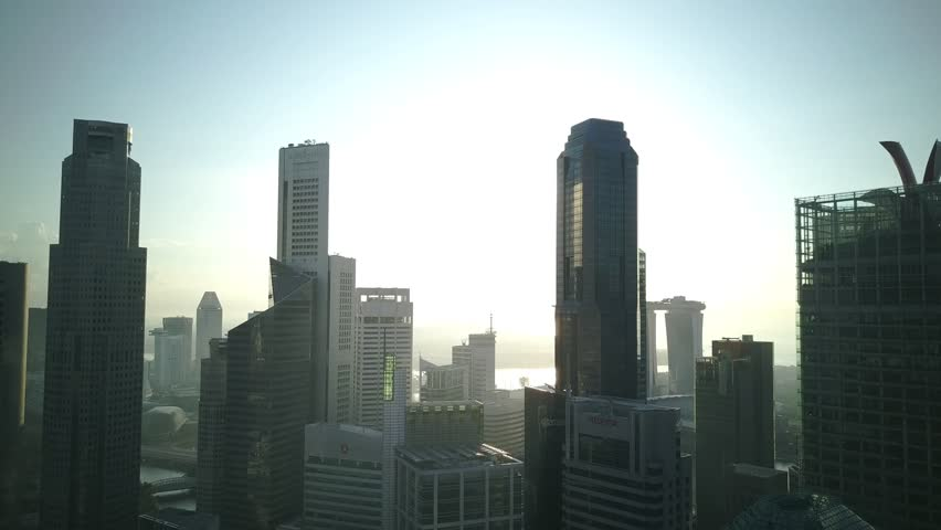 Beautiful backlit of morning sun on Singapore cityscape skyscrapers and the its surroundings.