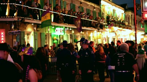New Orleans, LA - FEBRUARY 18: Group of police officers on Bourbon street with many people during Mardi Gras celebration on Saturday February 18, 2012 in New Orleans, Louisiana.