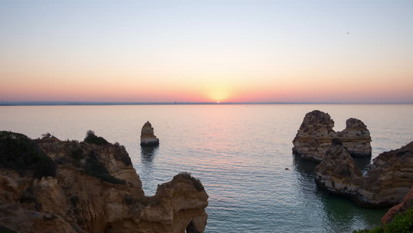 Beautiful time lapse of sunrise over the rocky atlantic ocean coast in Lagos, Portugal