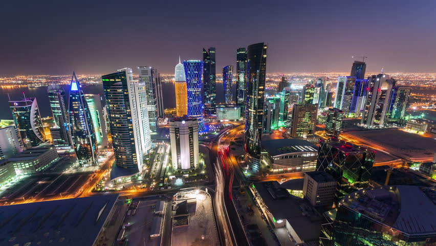 Doha Qatar skyscrapers tall buildings timelapse night lights downtown streets cars moving fast beautiful, Middle East