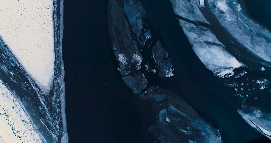 frozen river in aerial view, iceland