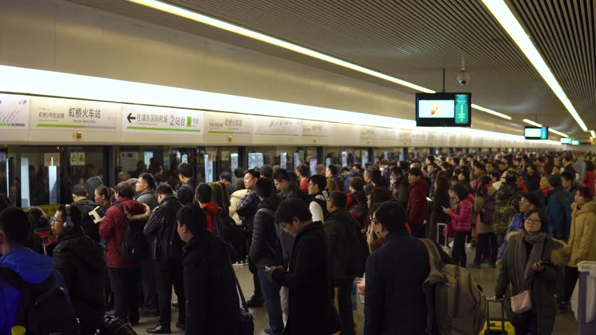 Shanghai, China - January 15, 2018: A large crowd of people enters the train car in the Shanghai Metro