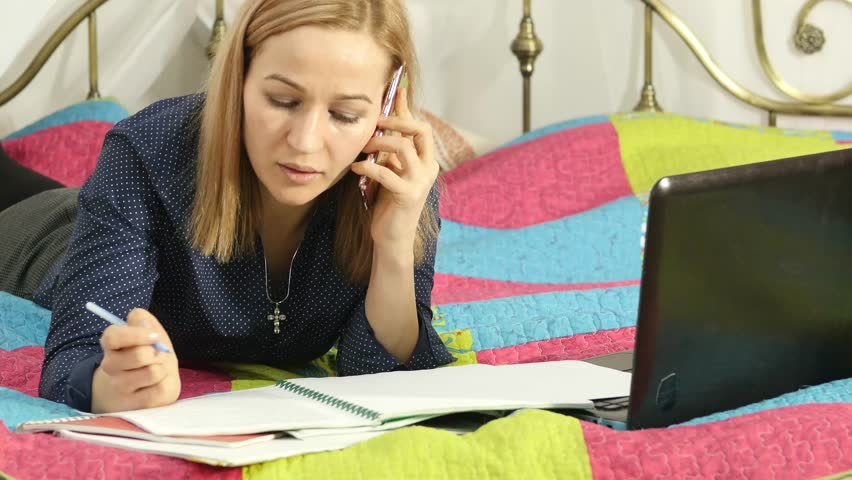 Beautiful student working on her laptop. on-line education in home. 4K | Shutterstock HD Video #1007247328
