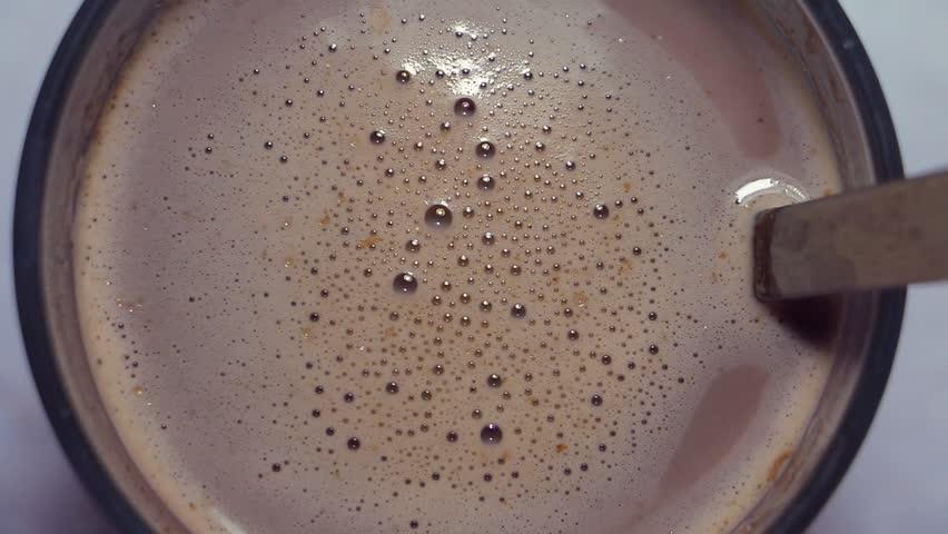 unfocused macro stir coffee/milkshake bubbles and foam texture