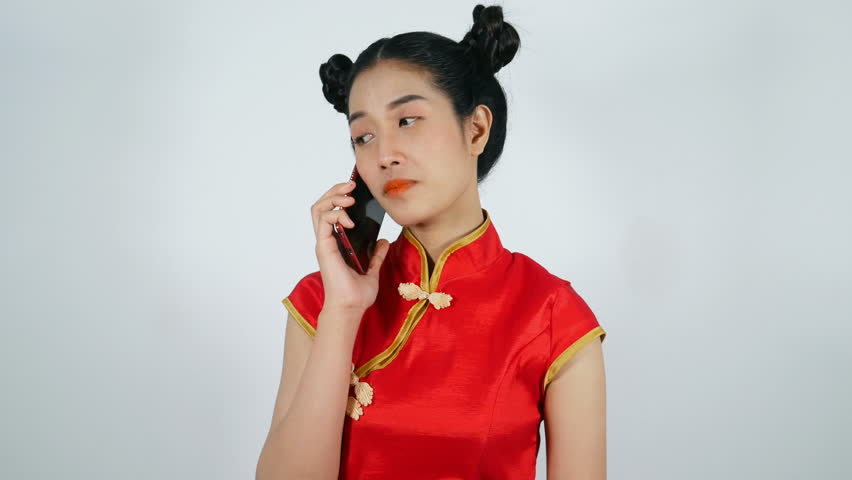 4k video of happy woman wear cheongsam and using mobile phone on a white background