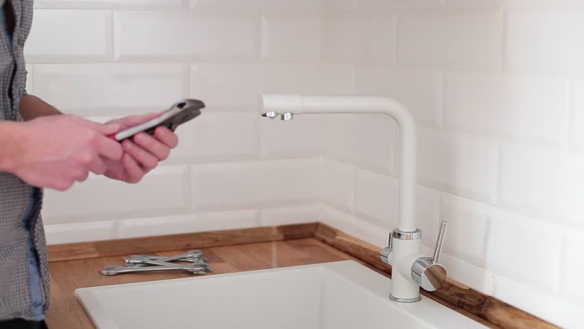 Plumber Repairs Faucet Stock Footage Video 8845966 | Shutterstock