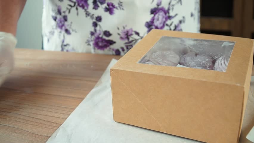 Laying marshmallows in a box. | Shutterstock HD Video #1007373208