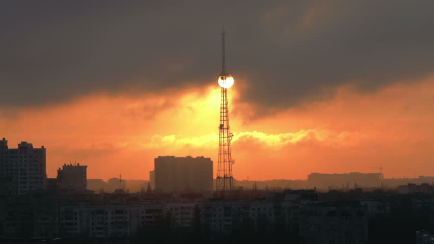 Beautiful sunset or sunrise on urban background with tv tower and buildings  | Shutterstock HD Video #1007386678