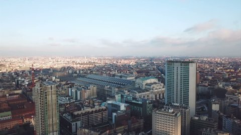 Milan aerial view, drone 4k shot over Milan Central Station on sunset