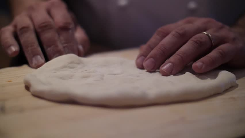 Focaccia is a flat oven-baked Italian bread product similar in style and texture to pizza doughs wood-fired stove. It may be topped with Rosemary herbs and tomatoes.  #1007416588