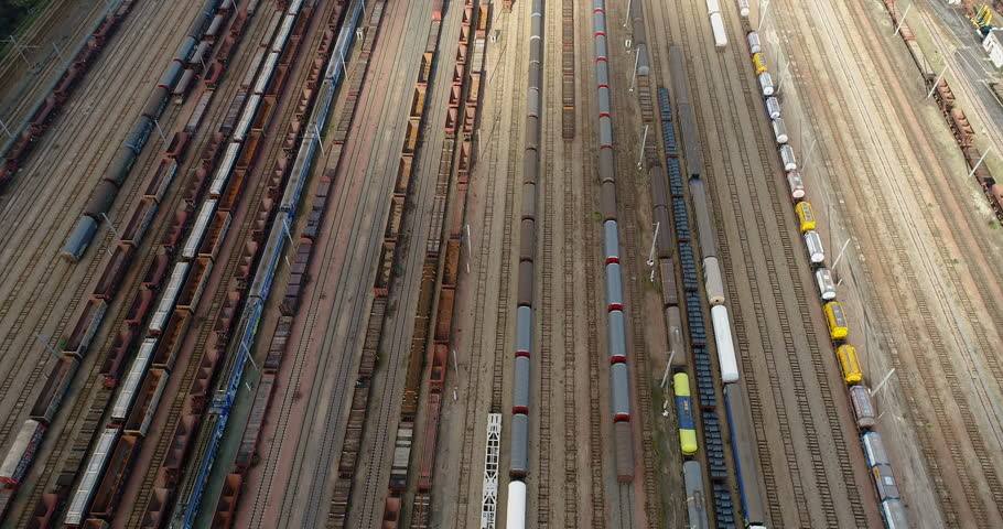 Station with freight trains and containers in aerial view | Shutterstock HD Video #1007419108