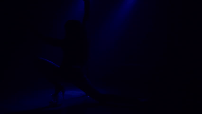 Young slim woman's silhouette dancing near the pole in dark room. Sexy Nude girl dancing erotic dance in the dark with smoke and blue spotlights. Sexy ass. | Shutterstock HD Video #1007437438