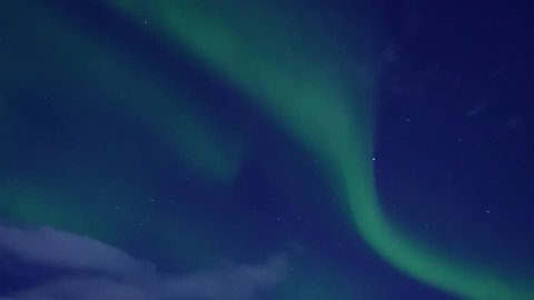 Northern lights, time lapse, Green aurora borealis dancing over the sea, Aurora borealis lights, arctic northern light in blue sky, night arctic lights time,clean weather day. Time laps ULTRA HD. 4K.
