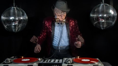an amazing grandpa, older man djing and partying in a disco setting. this version has overlayed video distortion and glitch effects