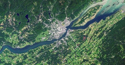 Very high-altitude overflight aerial of St. Lawrence River, Quebec City, Canada. Clip loops and is reversible. Elements of this image furnished by NASA