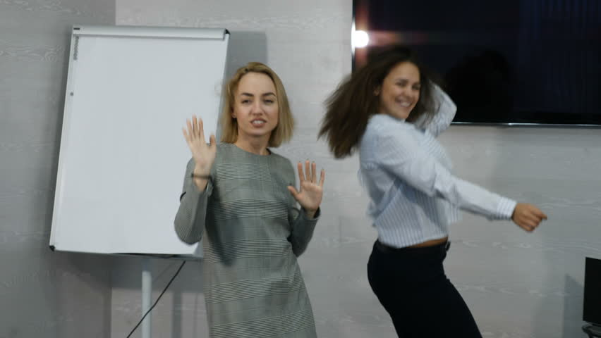 Young female business people dancing happy in office. Happy business team celebrating victory and dance in office. 4k | Shutterstock HD Video #1007518738