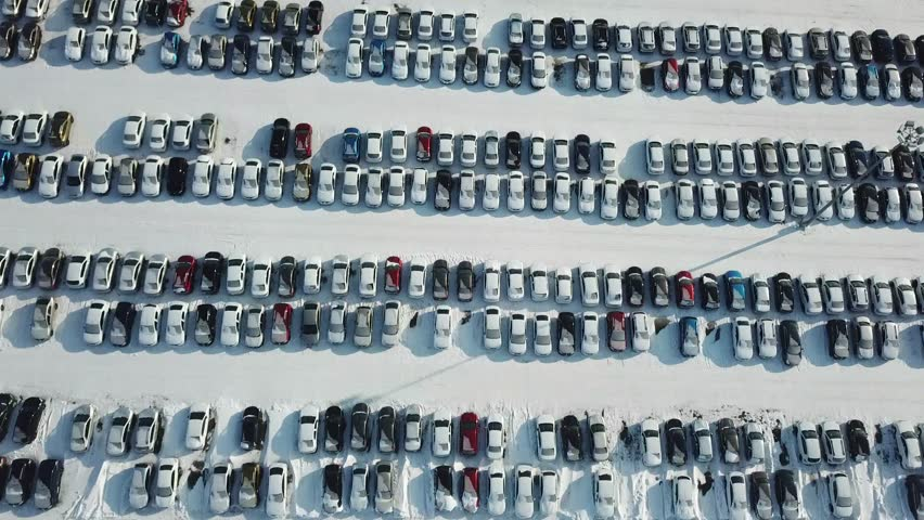 Aerial view of new car storage parking. Car industry.Market for sales in winter. | Shutterstock HD Video #1007521348