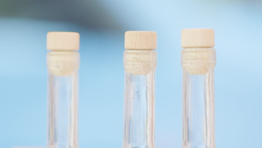 Slow motion shot of the top of three liquor bottles. Recycle for the future   Shutterstock HD Video #1007531908