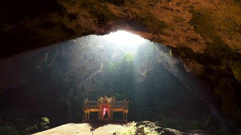 Sun shines on King's Rama V Pavilion in Phraya Nakhon Cave. Khao Sam Roi Yot National Park, Thailand. 4K, UHD