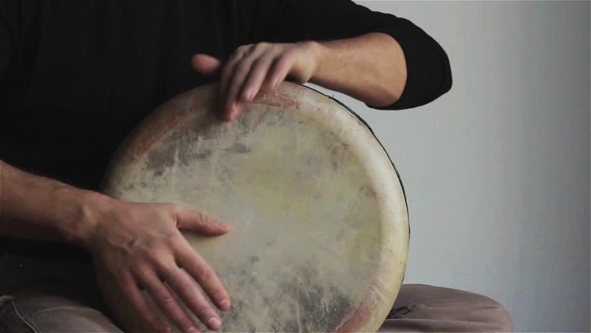 Man plays ethnic drum darbuka close up. Male hands tapping djembe bongo hands movement rhythm. Musical instruments world culture sound loud national