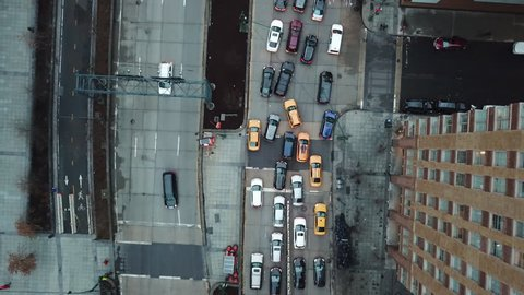 Traffic from aerial view above street zooming out; cars and taxis in gridlock congested lane New York City NYC 4K