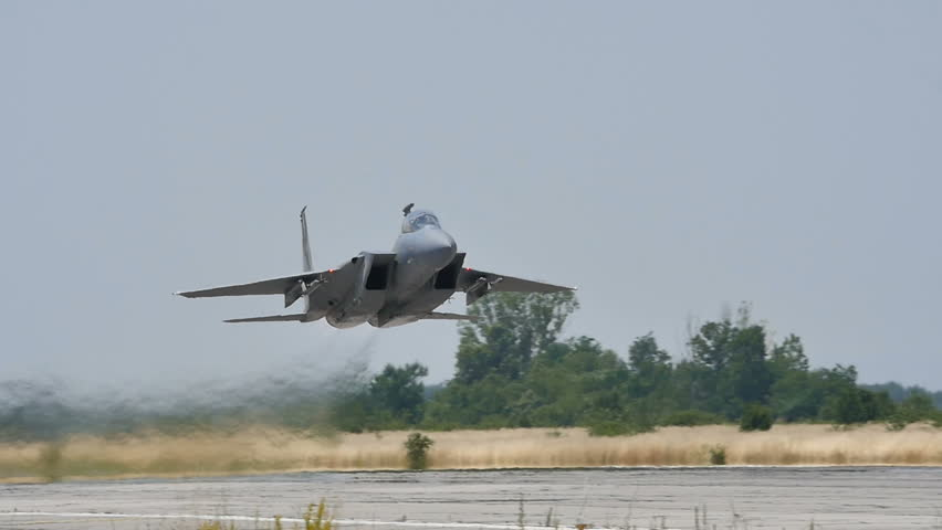 Military Combat Jet Aircraft just after Takeoff in Slow Motion 96fps Low Pass over the Runway. United States Air Force F-15C Eagle (Boeing Defense) at Graf Ignatievo (Plovdiv) Air Base 24 June 2016