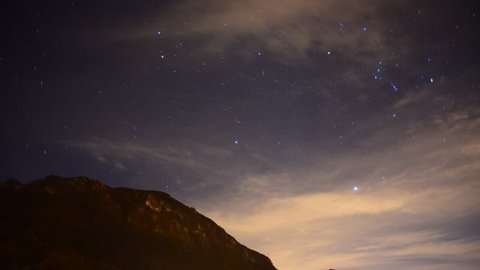 night sky with clouds and orion constellation time lapse