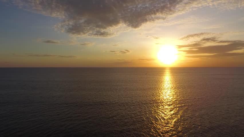 Picturesque scene of sunset over calm ocean waters | Shutterstock HD Video #1007641828