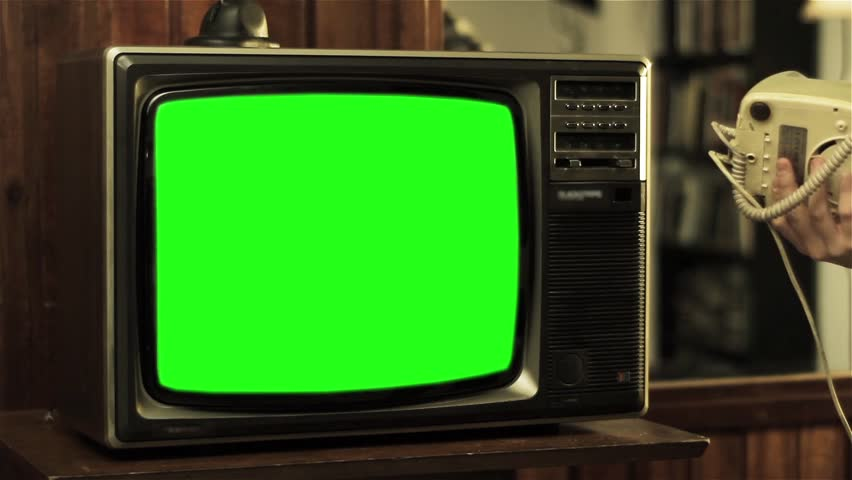 "Man Talking on Old Phone close to a Television with Green Screen. Ready to Replace Green Screen with any Footage or Picture you Want. You can do it with ""Keying"" (Chroma Key) effect in AE Effects. #1007642218"