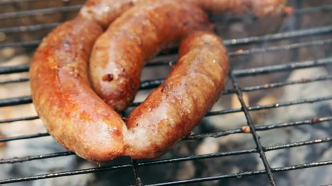 Grilled sausages on bbq. Variety Original Nuremberg Rostbratwurst . Pork ground meat, dill, nutmeg, garlic, cardamom, marjoram in the natural gut. There are also other types: rostbratwurst, currywurst