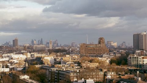 Rising aerial establishing shot of Kensington, Hyde Park and London cityscape