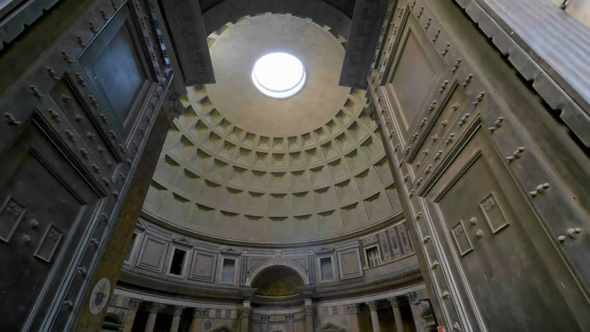 Rome, Italy Oct 8, 2017: Entrance door to pantheon view of pantheon ceiling spinning sun rays coming through the hole in Rome city italy.
