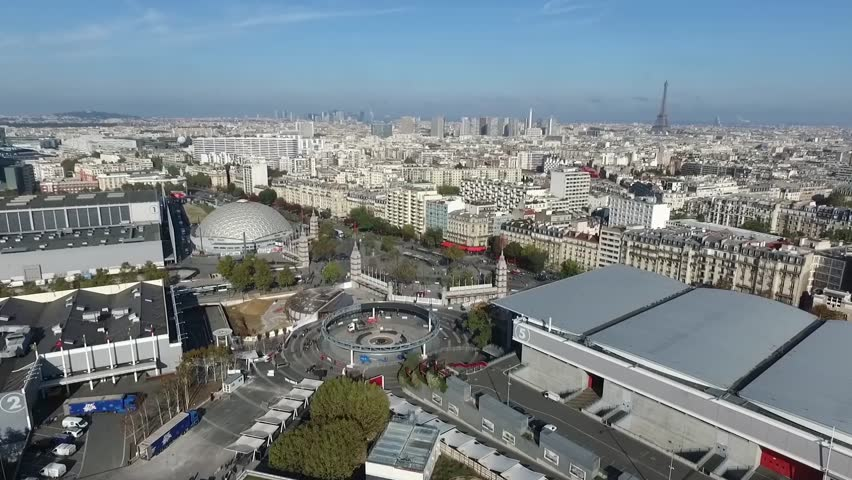 The city of Paris shot from the Paris Expo Porte de Versailles congress center / Paris drone footage on a clear blue sky / Eiffel Tower and Paris cityscape aerial footage. | Shutterstock HD Video #1007680228
