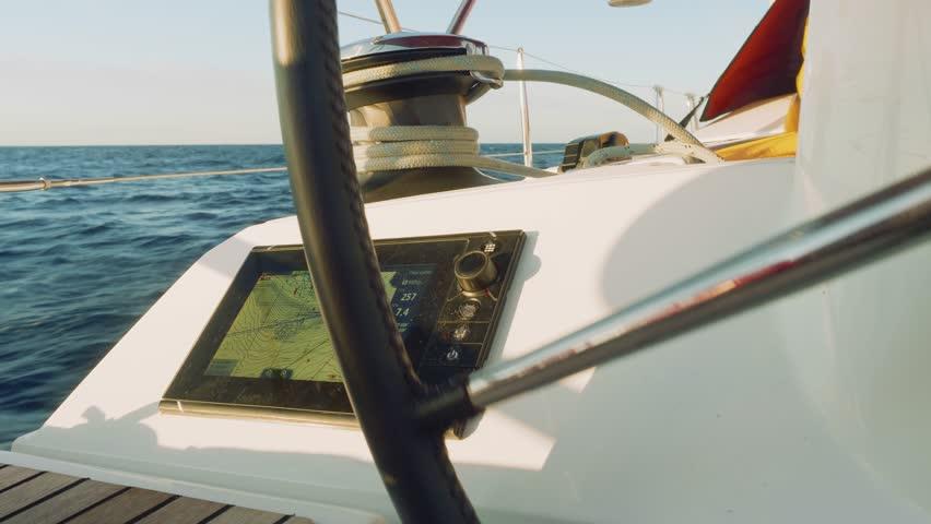 View of chart plotter fixed in cockpit near wheel of yacht | Shutterstock HD Video #1007687437